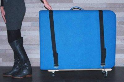 Transport-Rollbrett für mobile Massageliegen